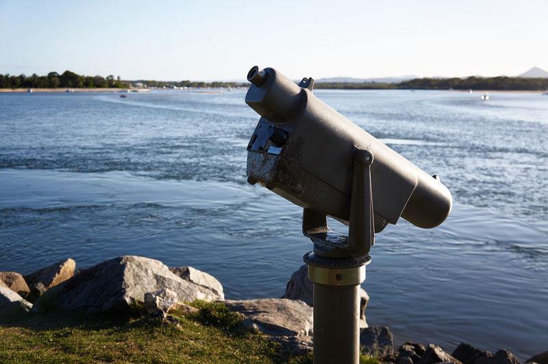 Coin-operated binoculars against lake