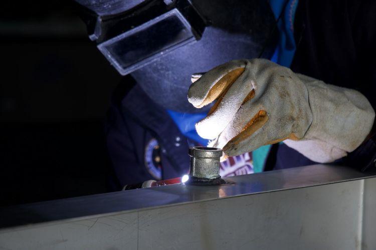 Man working on metal