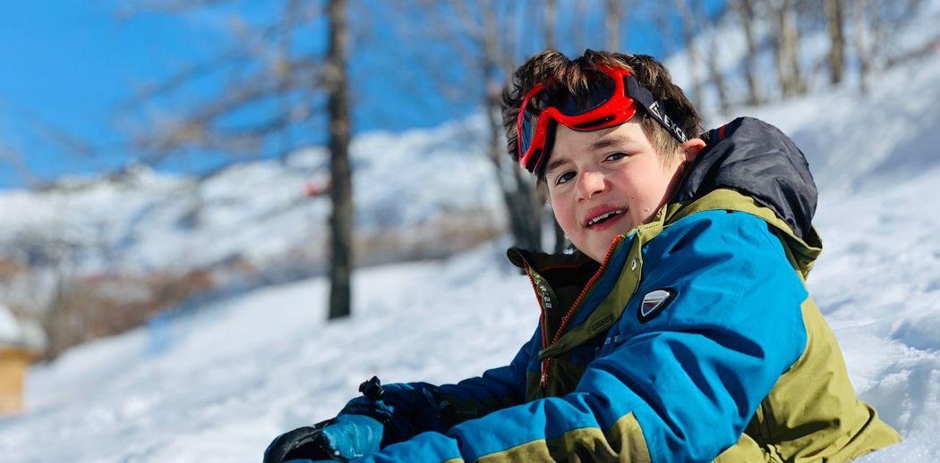 Portrait of boy in warm clothing on snow