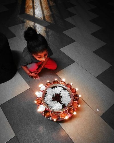 One Person High Angle View Light And Shadow Colorlight Deepam Indoors