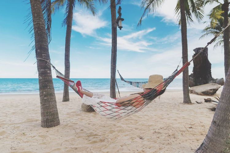Nice time on the beach นอนเปลชายหาด Travel Beach Land Water Sea Sky Sand Nature Horizon Over Water Tree Beauty In Nature Rope Tree Trunk Tranquility Scenics - Nature Trunk Horizon Day Swing Plant No People My Best Travel Photo