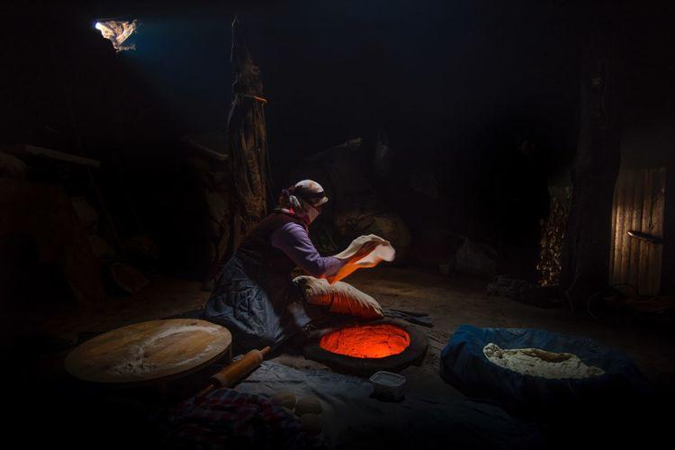 Man sitting in bowl