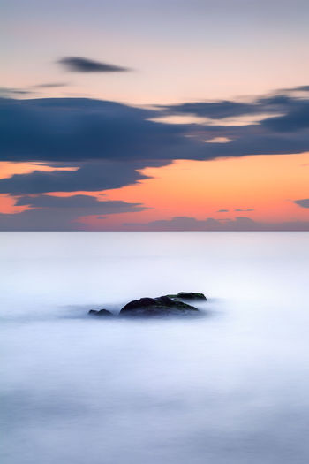 Cloud Nature Beauty In Nature Cloud - Sky Dramatic Sky Horizon Horizon Over Water Idyllic Landscape Long Exposure Nature No People Orange Color Outdoors Rock Rock - Object Scenics - Nature Sea Sky Solid Sunrise Sunset Tranquil Scene Tranquility Water
