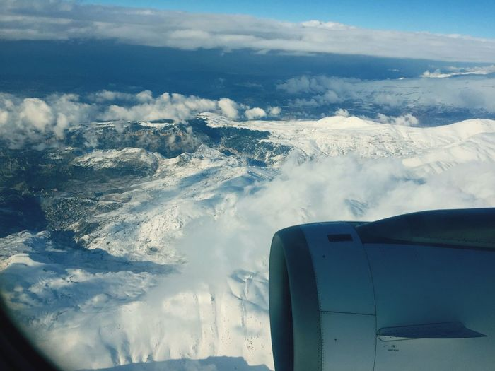Sky And Clouds Airplane Aerial View Snow Nature Sky Travel Beauty In Nature Cloud - Sky Mid-air Jet Engine Aircraft Wing Flying Air Vehicle Mode Of Transport