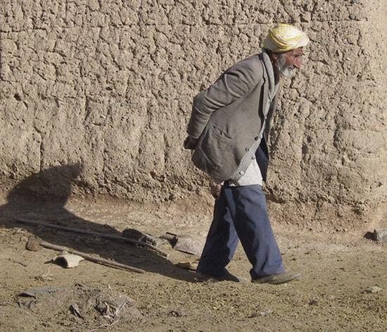 Old Man Backache Conseptual Middle East