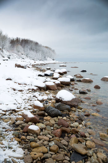 Scenic view of sea shore during winter
