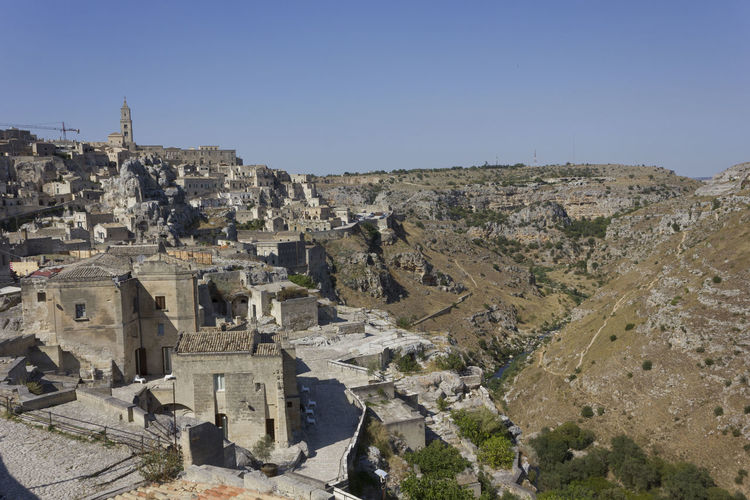 Matera Italy Unesco UNESCO World Heritage Site Landscape Murgia Sky Architecture Clear Sky Built Structure Building Exterior Nature History The Past Day Ancient No People Building Copy Space Travel Mountain Travel Destinations Environment City Sunlight Outdoors Ancient Civilization