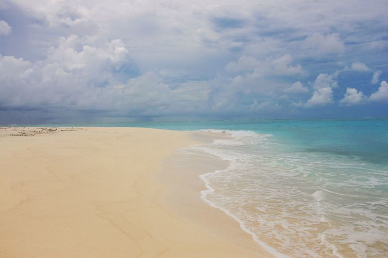 Sea Beach Sand Cloud - Sky Scenics Beauty In Nature Sky Horizon Over Water Water Nature Tranquil Scene Tranquility Shore Day Outdoors No People Travel Destinations Vacations Wave Sand Dune Fiji Fiji Islands Fidschi Fiji Beauty Nature