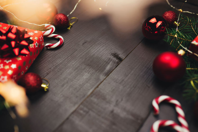 Christmas decorations on gray wooden table, christmas gifts. high quality photo