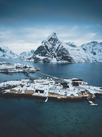 Sakrisøy drone photo Water Mountain Sky Winter Cold Temperature Scenics - Nature Beauty In Nature Snow Tranquility Tranquil Scene Cloud - Sky Sea Nature No People Mountain Range Snowcapped Mountain Day Transportation Outdoors Ice