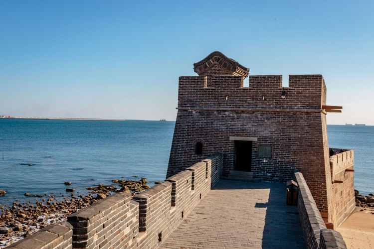 Ancient History Archaeological Site Architecture Castle Great Wall Hebei Sunlight Tourist Attraction Building Exterior Built Structure China Chinese Clear Sky Day Fortification Historic Site History Landmark Military Outdoors Qinhuangdao Sea Shanhaiguan Water