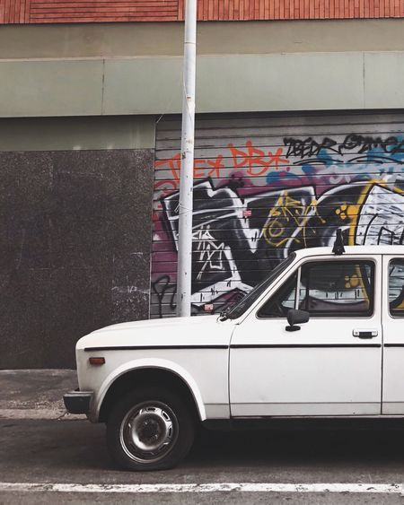Fiat 128 in Rome Retro White Car Rareview Fiat Mode Of Transportation Transportation Land Vehicle Built Structure Motor Vehicle Day No People Car City Outdoors Graffiti Street Parking