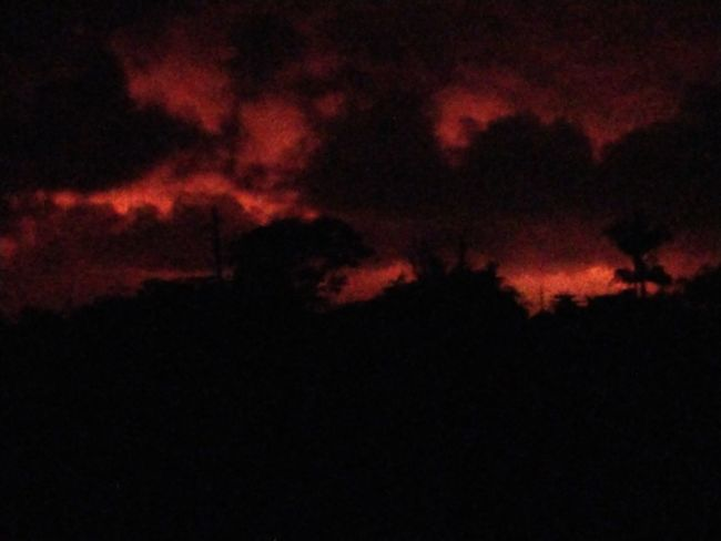 orange glowing sky from the lava flow on the Big Island of Hawaii 2018 Lava Flow Glow Big Island 2018 Big Island Lava Red Black Background Burning Sky Kilauea Active Volcano Volcanic Activity Big Island - Hawaii Islands