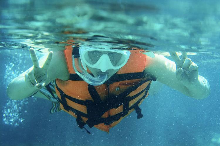 Close-up portrait of man swimming underwater