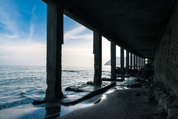 Below View Of Pier At Beach