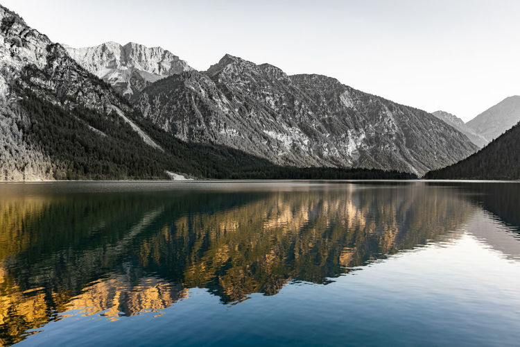 Mountain reflections at a lakes water. Mountain Scenics - Nature Beauty In Nature Reflection Water Lake Tranquil Scene Tranquility Mountain Range Sky Waterfront Idyllic Nature Non-urban Scene Cold Temperature Day No People Winter Outdoors Snowcapped Mountain Mountain Peak Reflection Lake