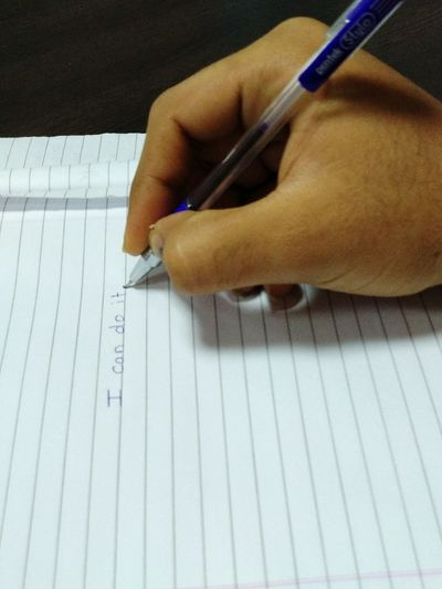 Cropped Hand Writing On Book With Pen