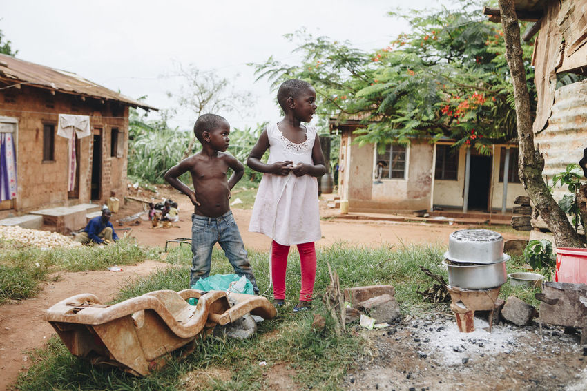 Africa African Bonding Boy Child Childhood Children Family Friends Friendship Fun Fun Girl Ground Home House Houses Outdoors People Playing Poor  Portrait Poverty Togetherness Village