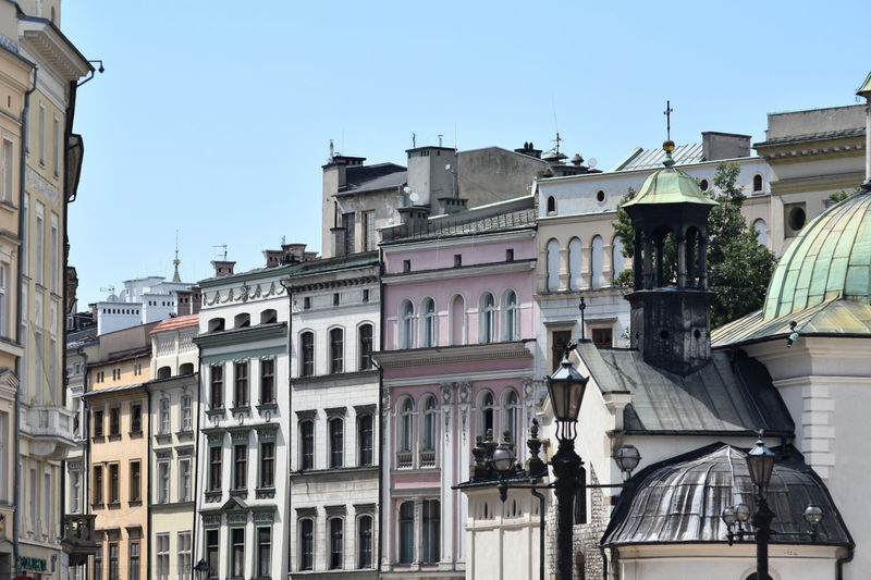 Low angle view of buildings in city against clear sky
