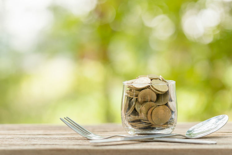 Close-up of wineglass on table against blurred background