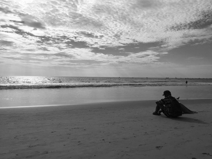 Sky Sea Water Real People Beach Cloud - Sky Land Leisure Activity Lifestyles Beauty In Nature Horizon Over Water Horizon Scenics - Nature Sitting One Person Tranquility Sand Tranquil Scene Outdoors