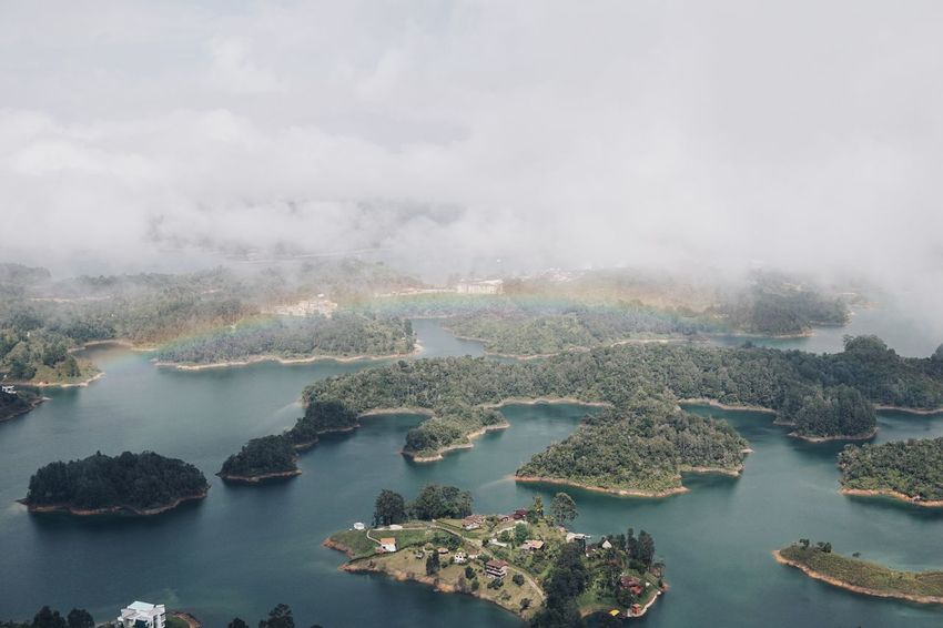 Guatape Colombia 1 Swinginginaplumtree Rainbow🌈 Rainbow View Stone Colombia Guatape Water No People Smoke - Physical Structure Nature High Angle View Beauty In Nature Day Sky Outdoors Tranquility