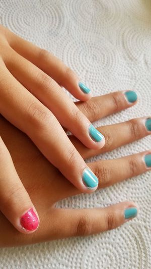Cropped painted fingernails