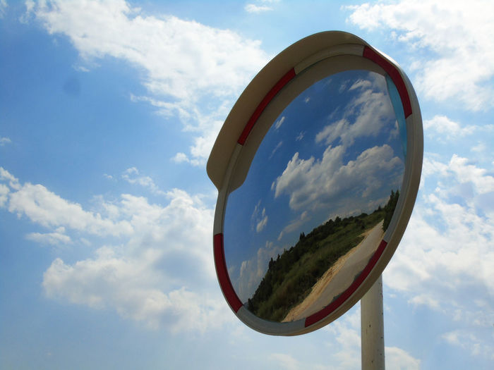 Cloud EyeEm Best Shots EyeEmNewHere Mirror Traffic Architecture Blue Built Structure Circle Close-up Cloud - Sky Day Design Geometric Shape Low Angle View Metal Mirror Nature No People Outdoors Reflection Shape Sky Sphere Sunlight White