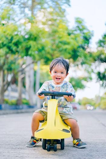 Cute boy sitting in toy