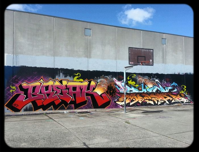 Graffiti wall with Sirum & Break in the community basketball court
