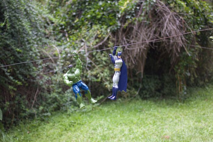 hulk and batman in the clothesline rappeling Adult Boys Child Childhood Children Only Clothesline Day Full Length Grass Headwear One Boy Only One Person Outdoors People Rappelling Superheroes Tree Young Adult Visual Creativity
