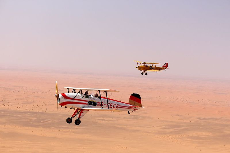 Vintage Aircraft Flying across the Nubian Desert Tigermoth Büker Jungmann Formation Flying Airplane Sky Sand Desert Beauty African Adventure Sudan EyeEmNewHere