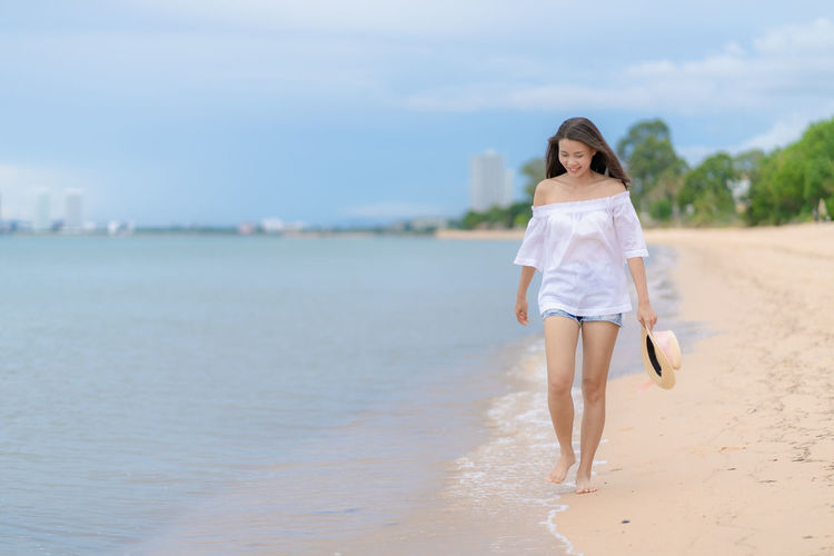 Full length of woman walking on beach
