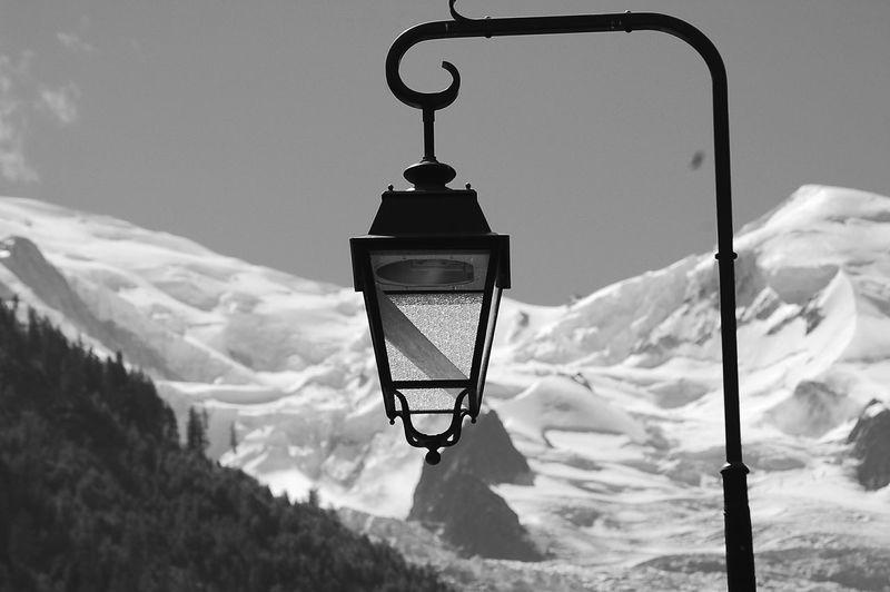 Close-Up Of Hanging Lantern Against Snowed Landscape