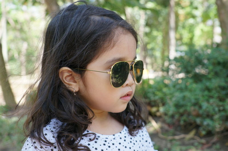 Nature Child Curly Hair Cute Fashion Girl Glasses Headshot Outdoors Portrait Stolen Shot Sunglasses