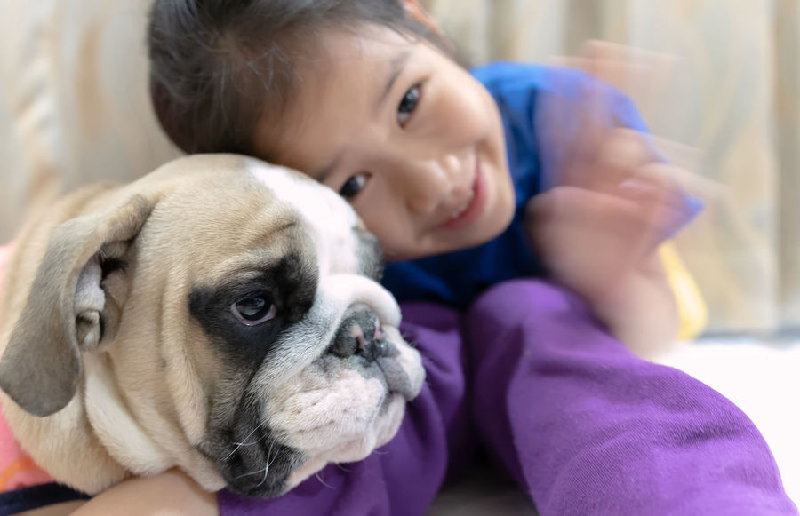 Domestic Pets Dog Canine Domestic Animals Child Portrait One Animal Mammal Childhood Animal Animal Themes Real People One Person Looking At Camera Emotion Focus On Foreground Indoors  Cute Innocence Pet Owner Small Girl