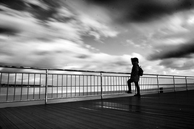 Full length of man walking on footpath