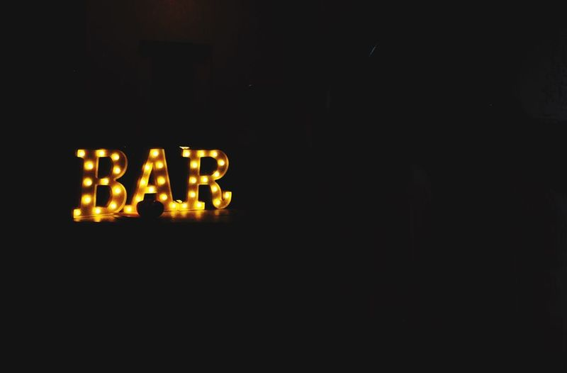"""First we need to find the bar"" Dark Illuminated Copy Space Communication No People Indoors  Text Lighting Equipment Night Glowing Close-up Darkroom Black Background Sign Capital Letter"