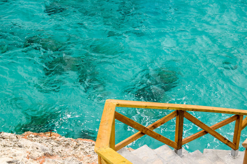 Beauty In Nature Blue Day High Angle View Ladder Nature No People Outdoors Pool Railing Rippled Sea Solid Staircase Summer Turquoise Colored Water Wood - Material