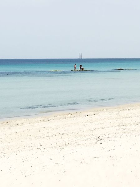 Beach Sea Sand Horizon Over Water Tranquility Tourism Sunny Tranquil Scene Landscape Travel Destinations Vacations Business Finance And Industry Blue Travel Clear Sky Sky Social Issues Beauty In Nature Nautical Vessel Water's Edge Live For The Story