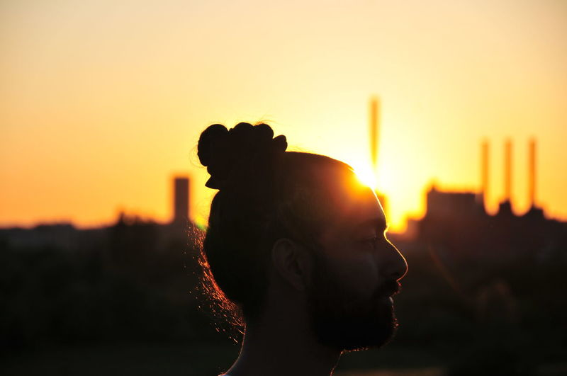 Close-up of silhouette man against clear sky at sunset