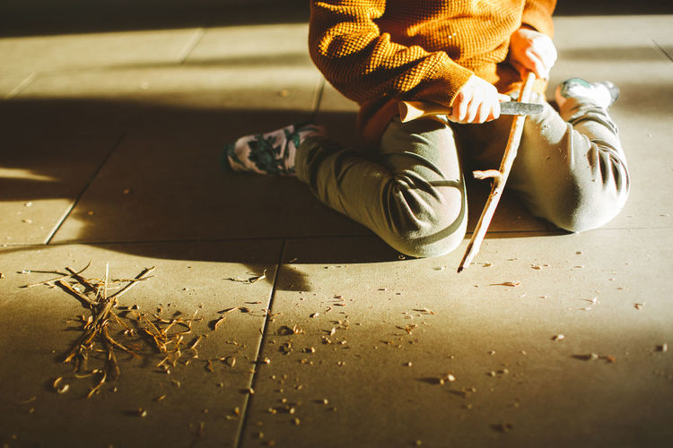 Low section of child on tiled floor