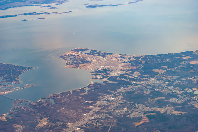 High angle view of city by sea