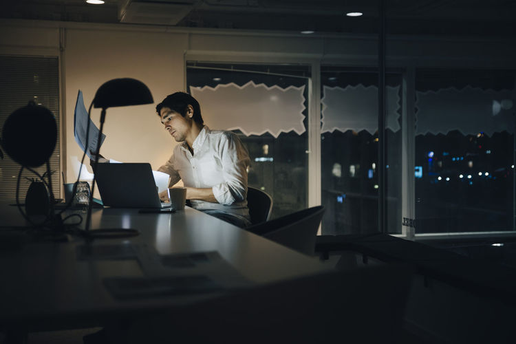 People working on table at night