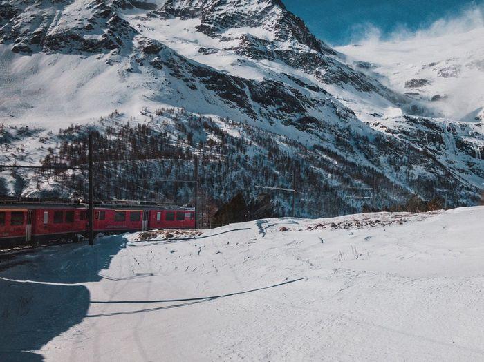 Train passing through snowy landscape