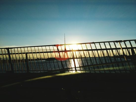 Security Sea Railing Bridge - Man Made Structure Reflection Sunset Outdoors Water Horizon Over Water Clear Sky Full Length Prison Sky Nature No People Day City Beauty In Nature