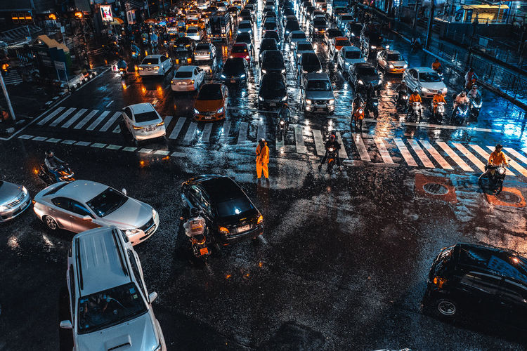 Architecture Building Exterior Car City City Life City Street Commuter Crowd High Angle View Incidental People Land Vehicle Mode Of Transportation Motor Vehicle Rain Road Street Traffic Traffic Jam Transportation Wet