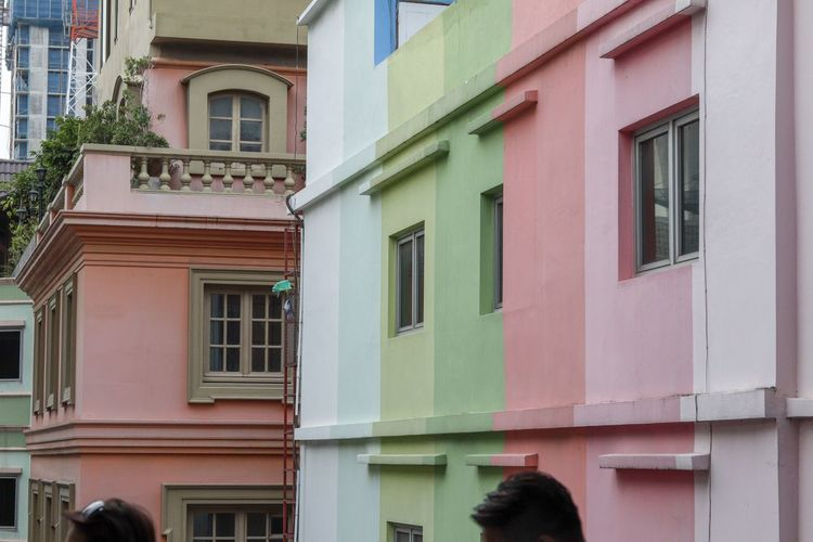 Low angle view of multi colored buildings in city