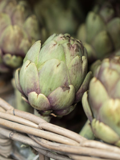 Artichokes Artichoke Food And Drink Food Healthy Eating Freshness Wellbeing Vegetable Basket No People Green Color Close-up Raw Food Container Selective Focus Large Group Of Objects Day Abundance Plant Still Life Organic Ripe