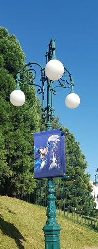 Here is a Photo shot of a 3 way Lamppost located within Disneyland Resort Paris. 2017 Blue Clear Sky Day Disneyland Paris Disneyland Paris 💚🎆🗼 Disneyland Resort Paris Disneyland Resort Paris 2017 Disneylandparis DLRP France France Trip Grass Green Color Nature No People Outdoor Lamps Outdoors Outdoors Photograpghy  Outside Paris, France  Shadows Sky Street Lamps Tree Trees And Sky